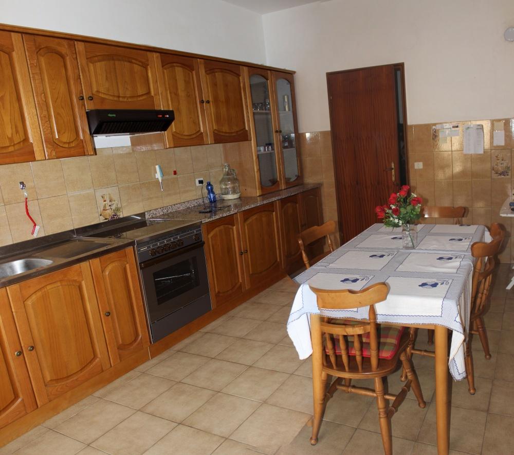 Foto 2 cucina appartamento + magazzino a Rocca di Capri Leone